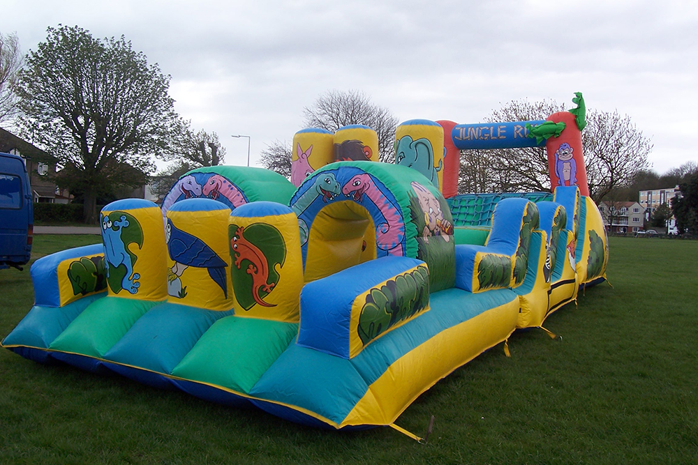 One of our most popular inflatables, particularly for corporate events - the Jungle Run Assault Course is great for the older children! Run through obstacles, climb through tunnels, and try to climb while racing friends and family with this endlessly fun Assault Course! Suitable for children up to 11 years.
