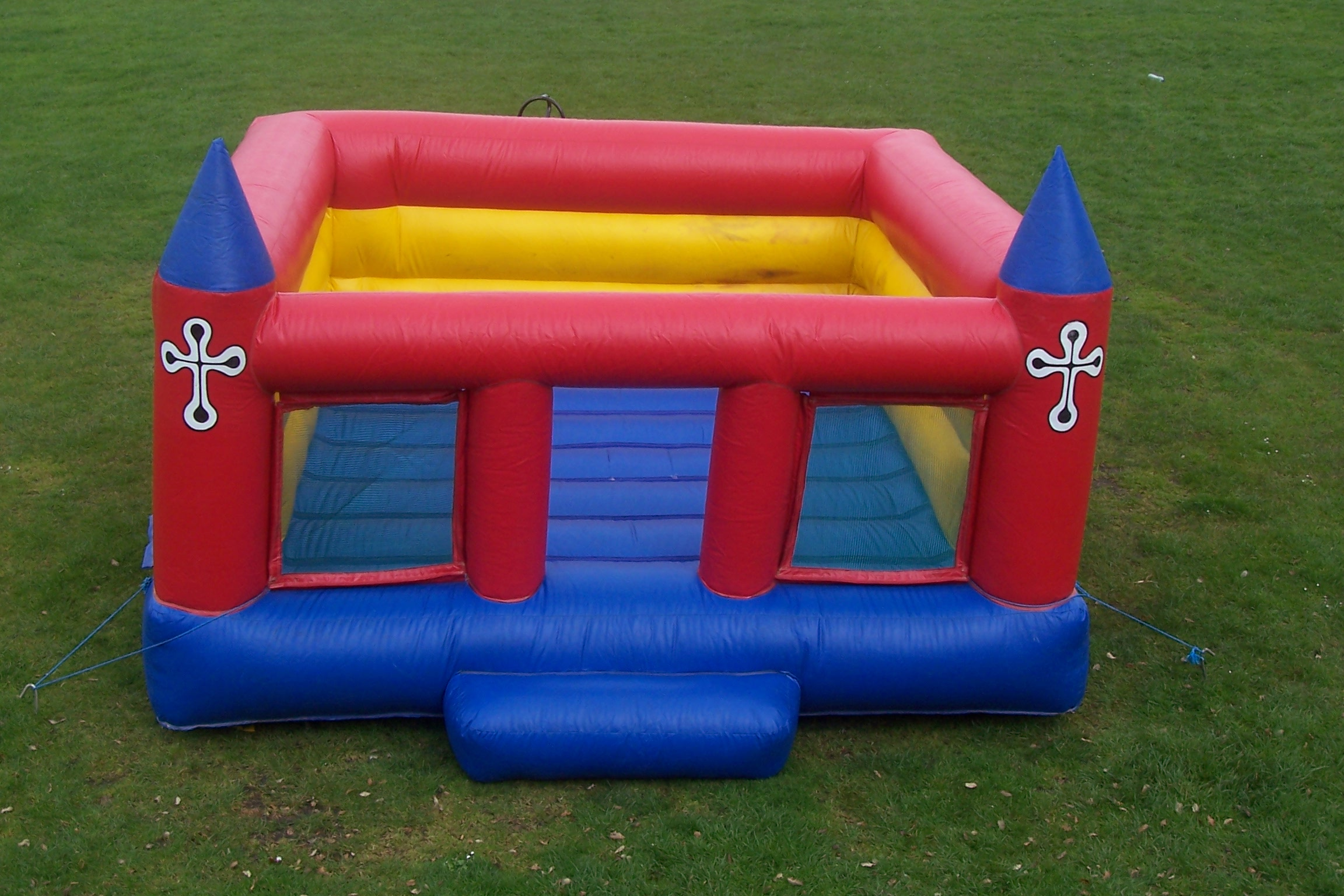 This Low Wall Bouncy Castle is perfect for use in halls with ceilings less than 8 feet high. Spacious and super bouncy, this castle is suitable for children up to the age of 13. Children must be supervised, as with all of our castles.