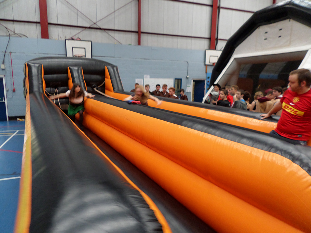 Put your strength to the test with this challenging fast-paced Bungee Run! Race against friends to see who can place their marker the furthest before the harnesses pull you back! Popular for corporate events such as festivals, carnivals, school fairs and school leavers parties! Suitable for all ages.