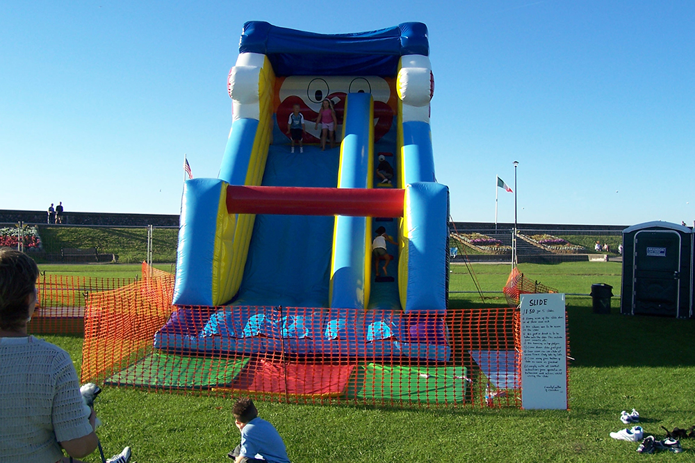 This huge slide is perfect for outdoor parties during the summer months, with endless sliding on one of our most popular inflatables. Race friends and try not to fall down as you climb to the top of this giant castle! Suitable for all ages.